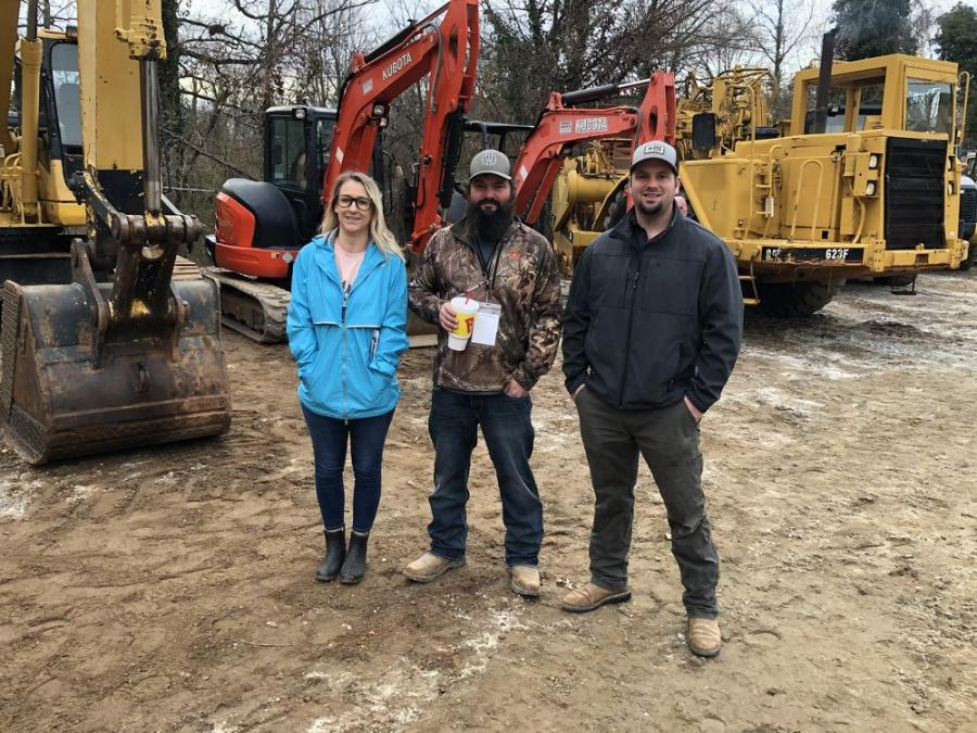 (L-R): Sarah, Todd and Travis Hedlund, all of Hedlund Construction in Belton, S.C., were interested in the Kubota excavators.