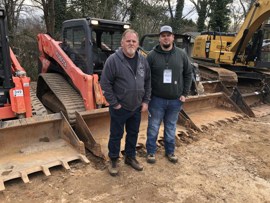 Gary (L) and Kenny Bryant, both of Bryant Enterprises in Burnsville, N.C., were hoping to get a good deal on a Kubota compact track loader.