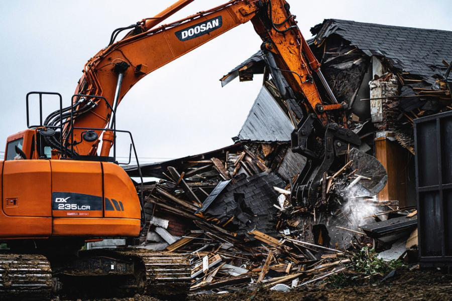 The reduced-tail-swing Doosan excavator was key in removing the dirt and debris.