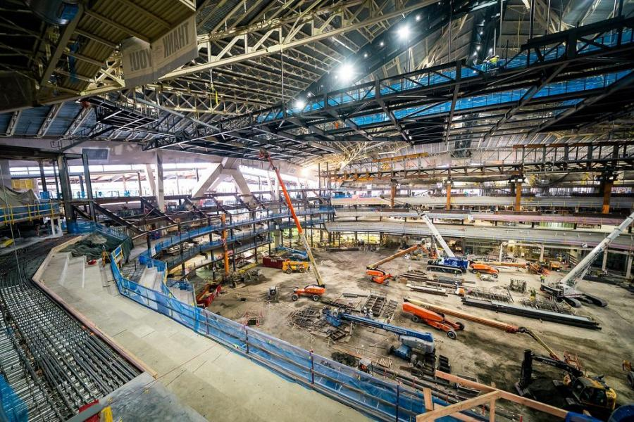 """Covering an area of approximately 190,000 sq. ft., the arena roof consists of bi-directional, steel space-truss """"three-pinned"""" arches with an intermediate post-tensioned cable system spanning between the main trusses and the perimeter concrete structure."""