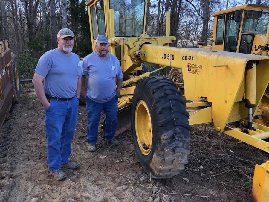 Chad Mathis (L) and Rex Shepherd, both of Little River Grading in Rhonda, N.C., liked this John Deere 570 motorgrader.