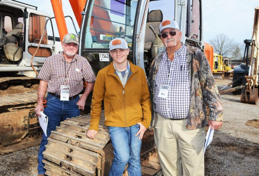 Interested in some of the excavators about to be auctioned (L-R) are Gary Horton, GMH Hauling, Wilmer, Ala.; and Landon Mitchaim and Ed Turner of John G. Walton Construction, Mobile, Ala.