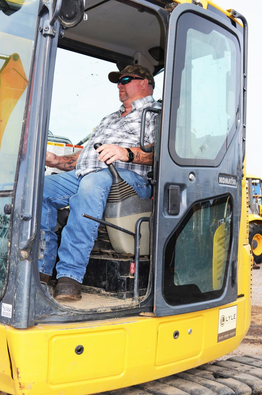 Test operating some of the mini excavators in the sale line-up is Jack Patterson of Southern Tree & Turf, Long Beach, Miss.