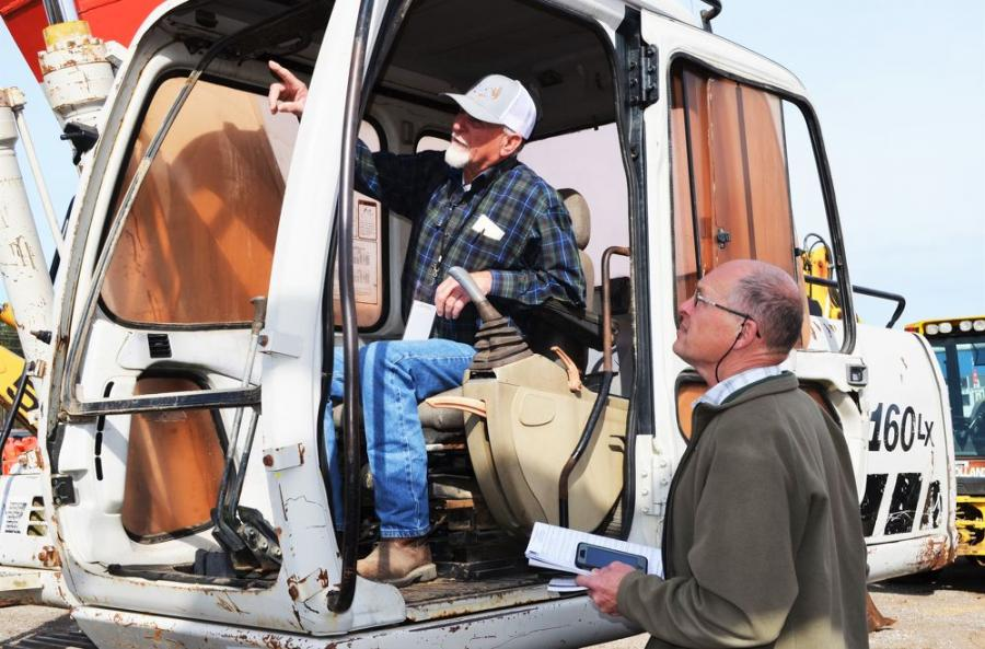 Farming and timber harvesting contractors Mike Turner (L) and Frankie Massey, of Lucedale, Miss., talk about a Link-Belt 160LX excavator of mutual interest.