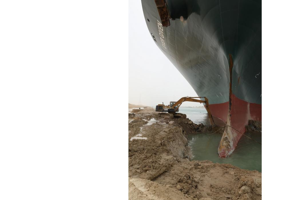 A Komatsu excavator is attempting to dislodge one of the world's largest container ships, the Ever Given, after the large vessel blocked a passageway of the Suez Canal in Egypt.