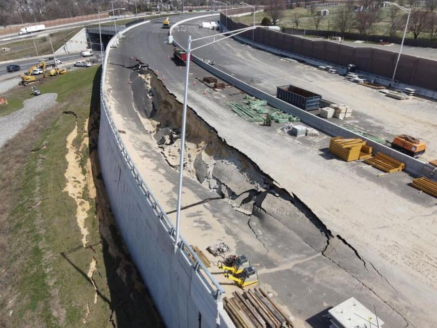 An aerial photo shows the top of a partially collapsed retaining wall on I-295 in Bellmawr. The bottom of the wall is bowed outward where the roadway surface on top fell in March 25.  (NJ.com photo)