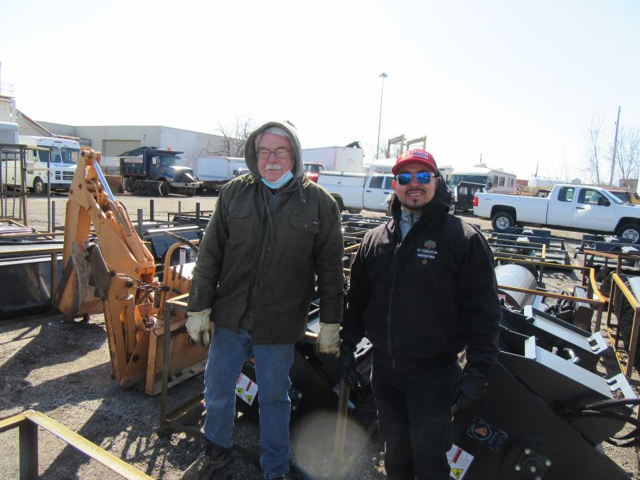Hubert Dietrich (L) of North Coast Consolidated Inc. and Higinio Soto of H Creative Landscaping discussed the variety of attachments up for bid at the auction.
