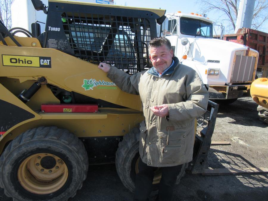 Dan Crawford of Teachout Mills Property Management considers a bid on this Caterpillar 242B skid steer loader.