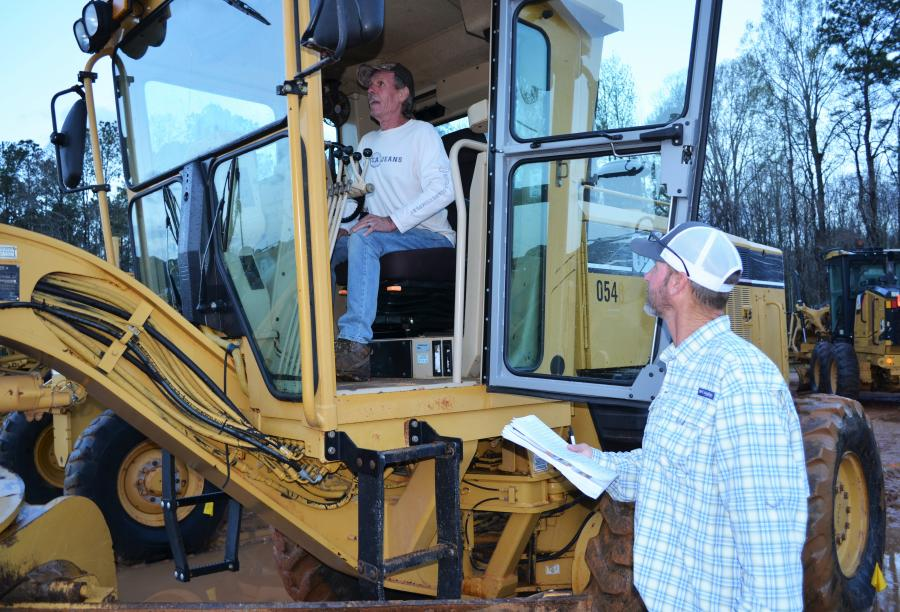 Motor graders were on the minds of Jason Thurman (in cab) and Bryan Thurman, both of Thurman Construction, Chipley, Fla.