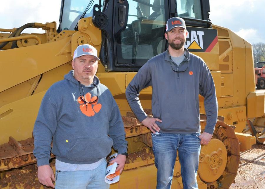 Representing their team while looking over some of the crawler loaders in the sale line-up, including this Cat 963D, are Jason Barnes (L) and Caleb Geiger of Geiger Forestry, Westminster, S.C.