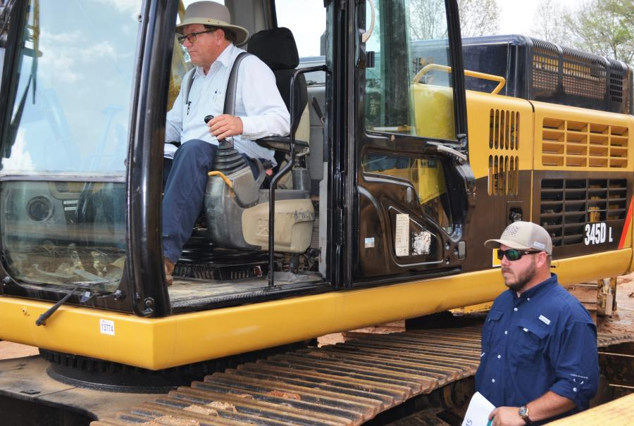Test operating and inspecting one of the big Cat's in the sale are Glenn Warren (operating) of Glenn T Warren & Company, Blountstown, Fla., and Scott Brown of Skar Construction, Hosford, Fla.