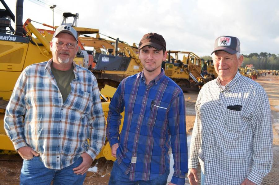 Enjoying the auction action on day three (L-R) are Steve Sloan and the father-son team of Jonathan and Thomas Curtis of Thomas Curtis Logging, Jasper/Double Springs, Ala.