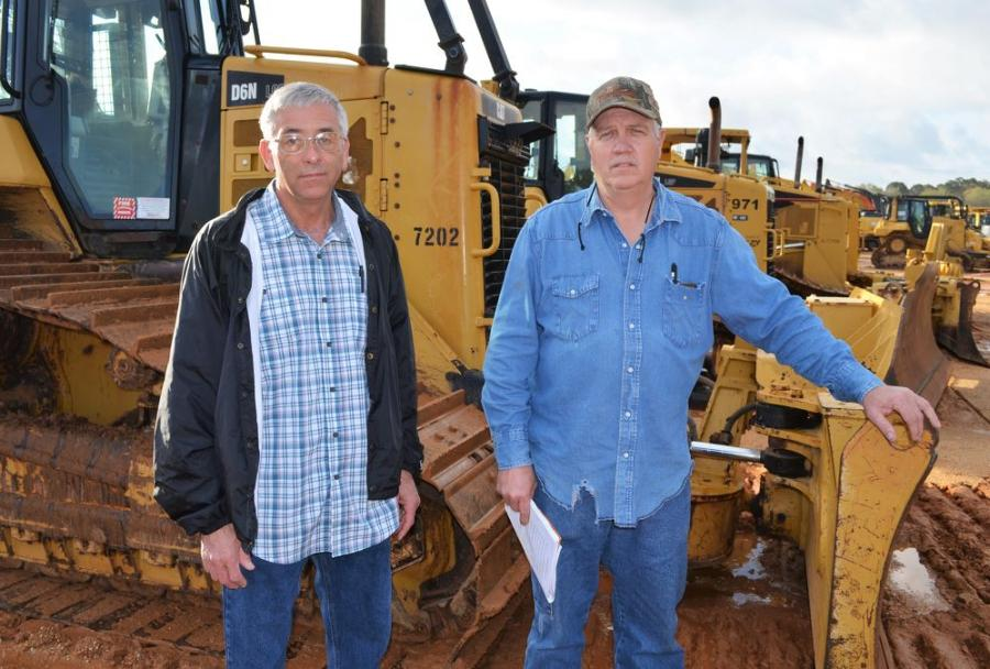 Checking out the dozers in the sale are Tim Mahan (L), Southern Forestry, Golden, Miss., and Ronnie Washburn of Washburn Logging, Reagan, Tenn.