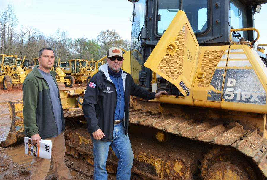 Opening up a Komatsu D51PX dozer of interest are Chris Benefield (L) and J.B. Dunn of J.B. Dunn Operations, Roanoke, Ala.