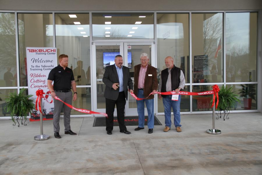 (L-R) are Keith Kramlich, Takeuchi-US product and training manager; Jeff Stewart, Takeuchi-US president; Tom Crow, chairman of the Jackson County (GA) board of commissioners; and James Tipton of Tipton Construction.
