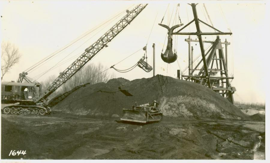 The machine that R. G. LeTourneau's photographer intended to highlight in this mid-1930s image is the straight dozer on what appears to be a Best or Cat Sixty, but it provides a beautiful contrast between a P & H dragline and a clamshell dredge. Dredges of this type were used extensively in levee construction in northern and central California.  (R. G. LeTourneau, Inc. photograph, Maier-Daily Papers,  HCEA Archives)