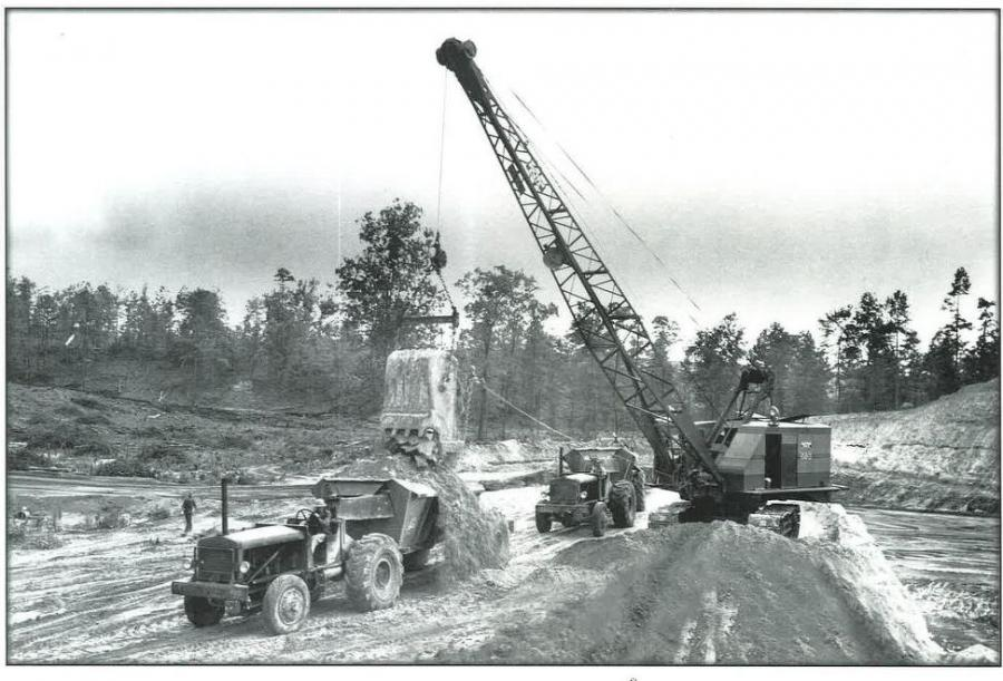 Swinging a 3 cu. yd. bucket, this Bucyrus-Erie 54B dragline heap loads a fleet of Euclid FDT bottom dumps. The 54B was the largest B-E machine of its era that was manually operated. 