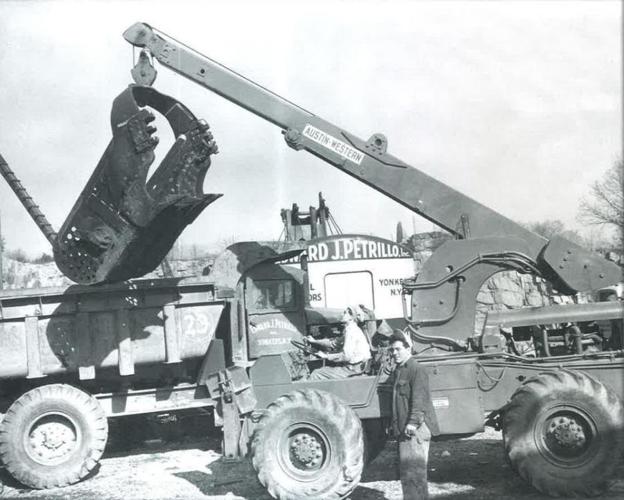This dragline bucket is getting a lift into a Euclid end dump for a trip to the shop. An early Austin-Western crane does the honors in this shot taken in 1957 at Edward J. Petrillo Inc.'s yard in Yonkers, N.Y.  (Austin-Western Road Machinery Company collection, HCEA Archives)