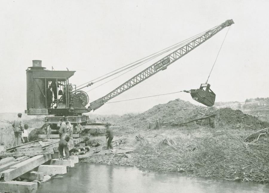Dragline service was not a common application for locomotive cranes. This Brownhoist No. 4 wields a 1-yd. Schnable bucket. This bucket consisted of a pivoting shell inside a fixed frame, and it dumped out its back end by releasing the tension of the drag line, causing the back of the shell to drop away from the back gate of the frame while pivoting at the front of the frame. After dumping, the shell returned to its horizontal digging position, with the back gate blocking the open back end of the shell.  (Brown Hoisting Machinery Company catalog, 1919, Donald W. Frantz Collection, HCEA Archives)