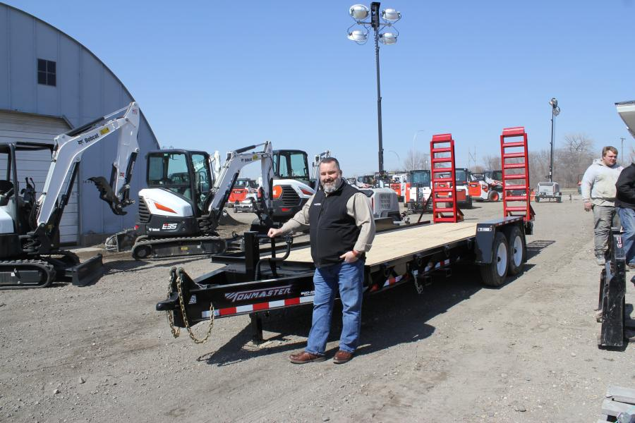 Bob Pace, Towmaster regional sales representative, with one of Towmaster's most popular models — the Towmaster T16D 16,000-lb. heavy-duty trailer with 20-ft. deck and 28,000-lb. axles.