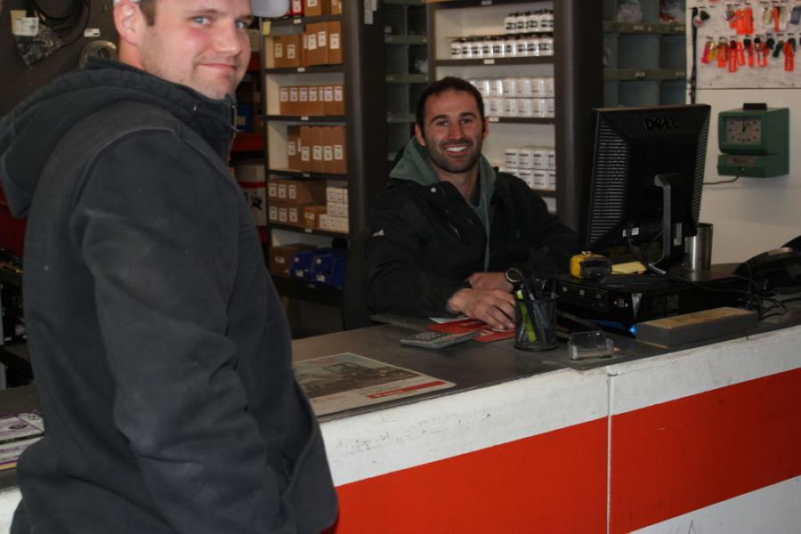 Justin Kidrowski (L) of Arcs & Sparks Inc. in Spicer, Minn., with Danny Cox, service and parts manager of Farm-Rite of Willmar, taking advantage of the parts special for the open house.
