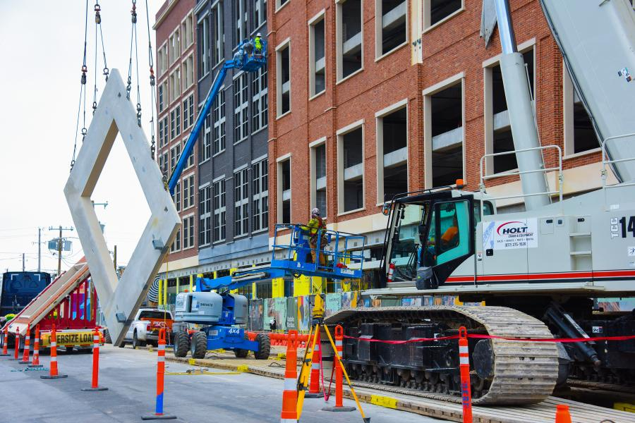 Derr and Isbell Construction LLC rented a Link-Belt 140-ton (127-t) TCC-1400 telescopic crawler crane from HOLT Equipment of Irving, Texas, to place more than 250 precast panels on the bottom 10 stories of the new building.