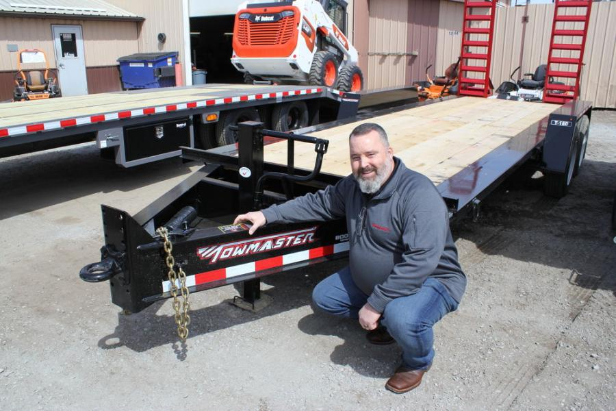 "With the company's most popular T16D 16,000-lb. trailer with 20-ft. deck and two 8,000-lb. axles is Bob Pace, Midwest product representative of Towmaster. ""Farm-Rite has trailers in stock if you need a Towmaster heavy-duty trailer,"" said Pace."