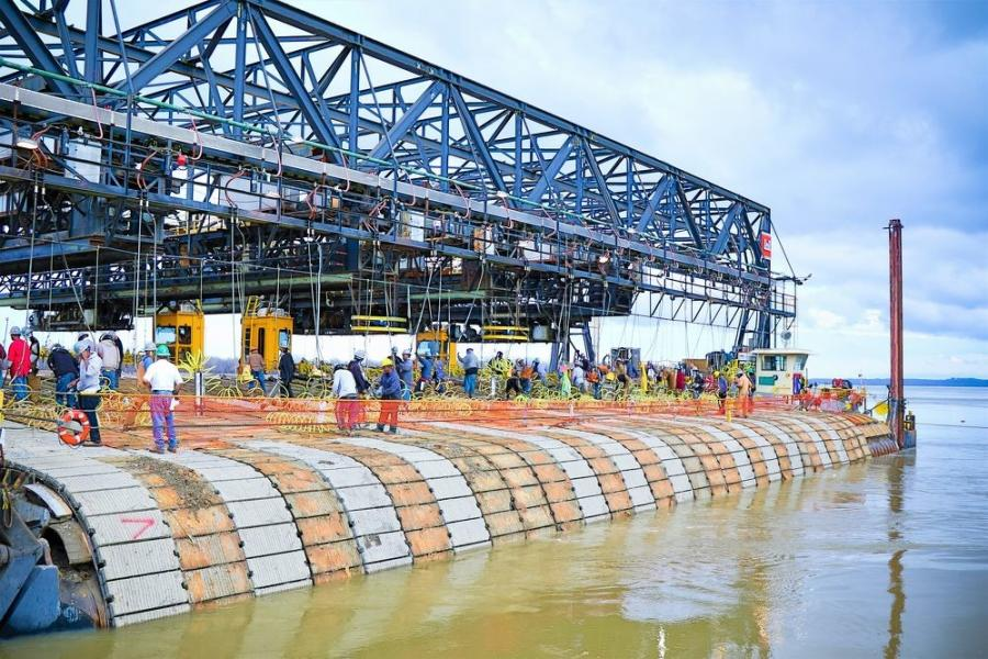 The Mat Sinking Unit sinks articulated concrete squares into the Mississippi River during a recent revetment season. Each year, the unit sinks hundreds of thousands of squares into the river to fortify its banks. (USACE photo)