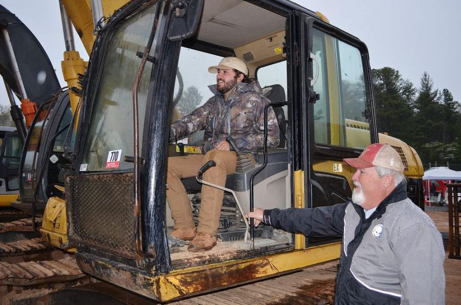 McKrae Alexander (L) of Mossy Creek Contracting, Cleveland, Ga., and Reggie Nelson of Nelson Grading, also based in Cleveland, test operate a Caterpillar 315CL excavator.