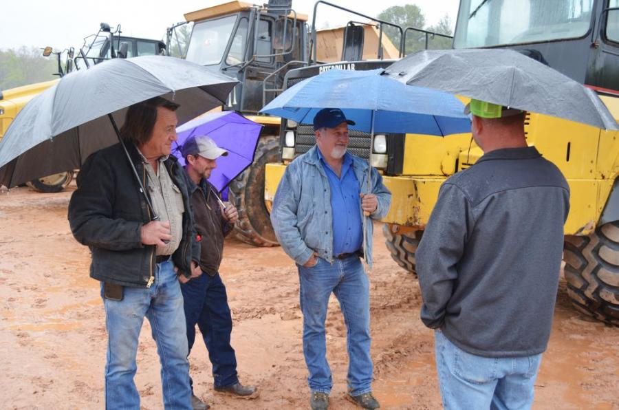 These local boys were deep in conversation about the big iron being auctioned off in Blairsville.