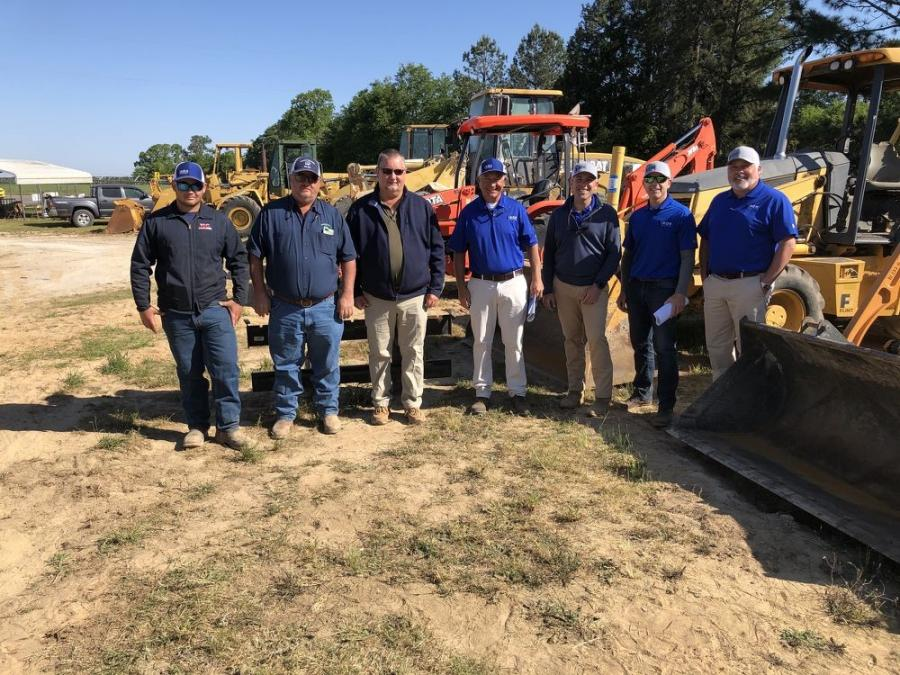 (L-R) are Ryan and Tony Rucker of R&T Grading in Pelion, S.C.; Kelly Green of Trans–Tel Inc. in Pelion, S.C.; and Iron Auction Group's Ross McMillan, Jared McGaffee Mike Finley and Matt McGaffee.