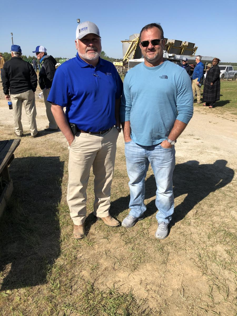 Iron Auction Group's Matt McGaffee (L) catches up with Jeff Hylton of Jennmar.
