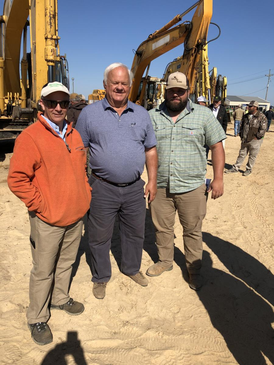 (L-R) are Dick Mizzell of Heavy Equipment Consulting in Lexington, S.C., and George and Brett Hair, both of Hair & Sons Trucking in St. Matthews, S.C.