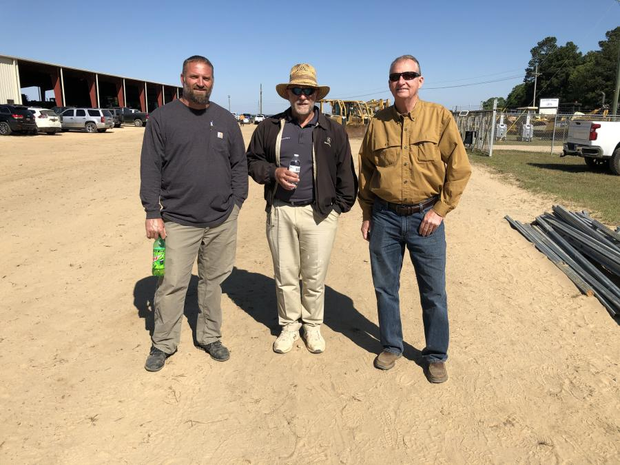 (L-R) are Kenny Fallow and Jim Pasko, both of Eagle Excavating in Lexington, S.C., and Rick Thain of Southern Quality Trucks in Lexington, S.C.