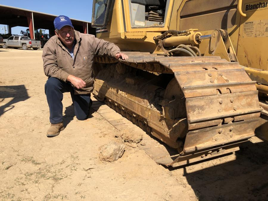 Clayton Trapp of Trapp Construction in Blythewood, S.C., inspects the undercarriage of this Cat D5G LGP dozer. He thought it was in good shape and planned to bid on it.