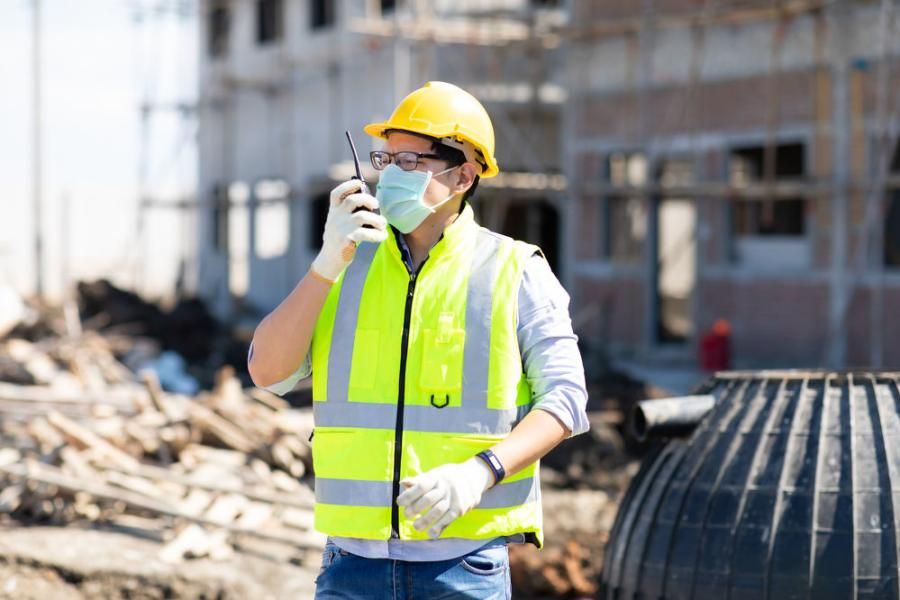 Despite employees getting vaccinated, contractors will still require masks and social distancing on the job site.