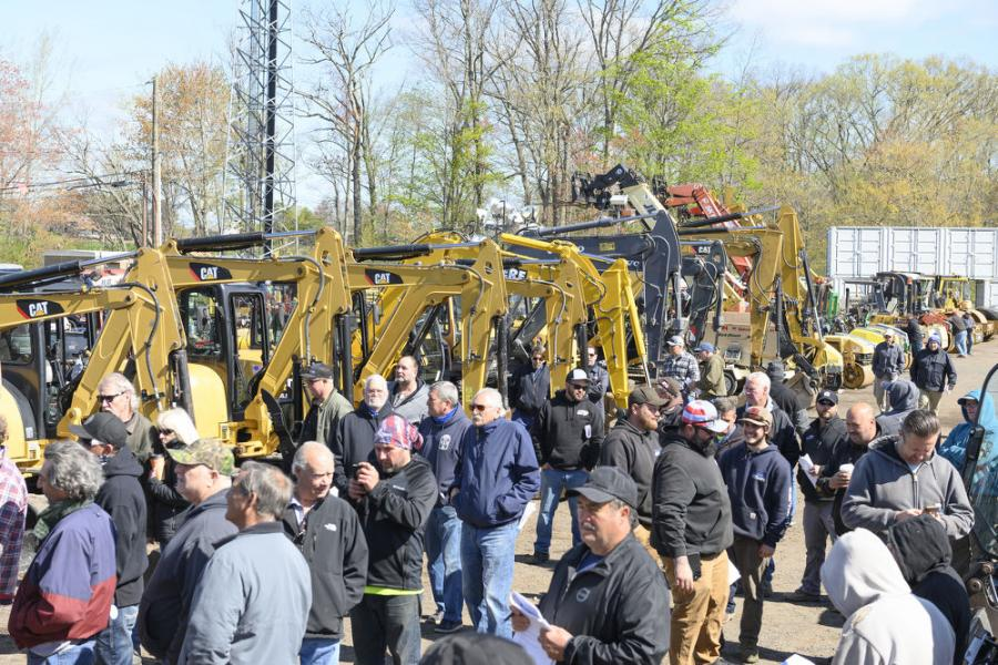 A large crowd follow the auction truck at the Sales Auction Company held May 1, 2021, in Windsor Locks, Conn.