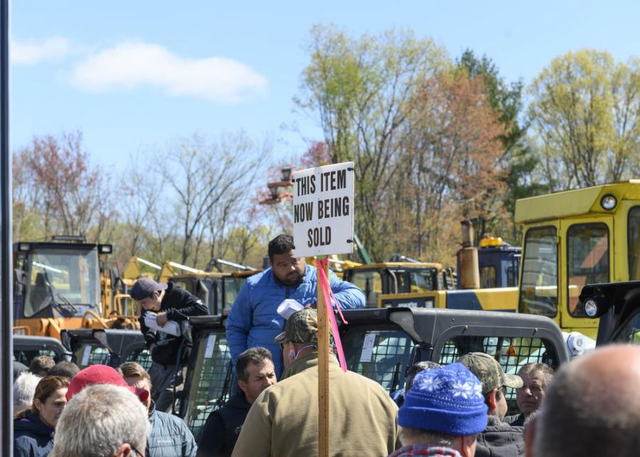 Crowds gather as the line makes its way down the row of skid steers to a 2017 Bobcat S770.