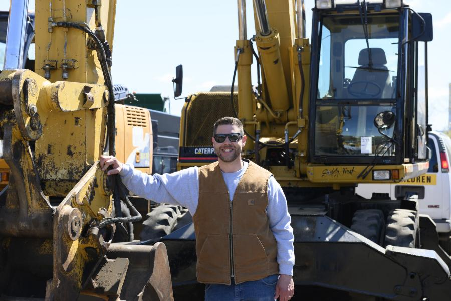 Nathan Cadenhead of Sales Auction Company with a 2020 Caterpillar M320 rubber-tire excavator.