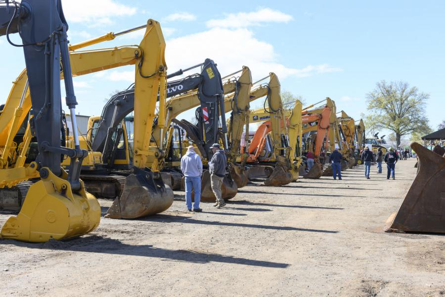 Bidders check out the many hydraulic excavators available.
