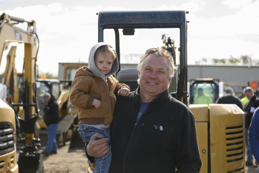 Mark Swiatowiec and grandson Mark Swiatowiec III check out a Caterpillar 304E mini-excavator.