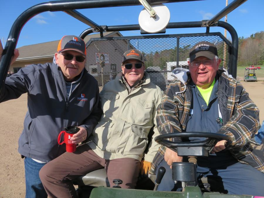 (L-R): Tim Slack of Tim Slack Auction Realty LLC, and Leo Krivickas and Skeeter Wykoski of Three Lakes Truck and Equipment are enjoying a day out at the auction.