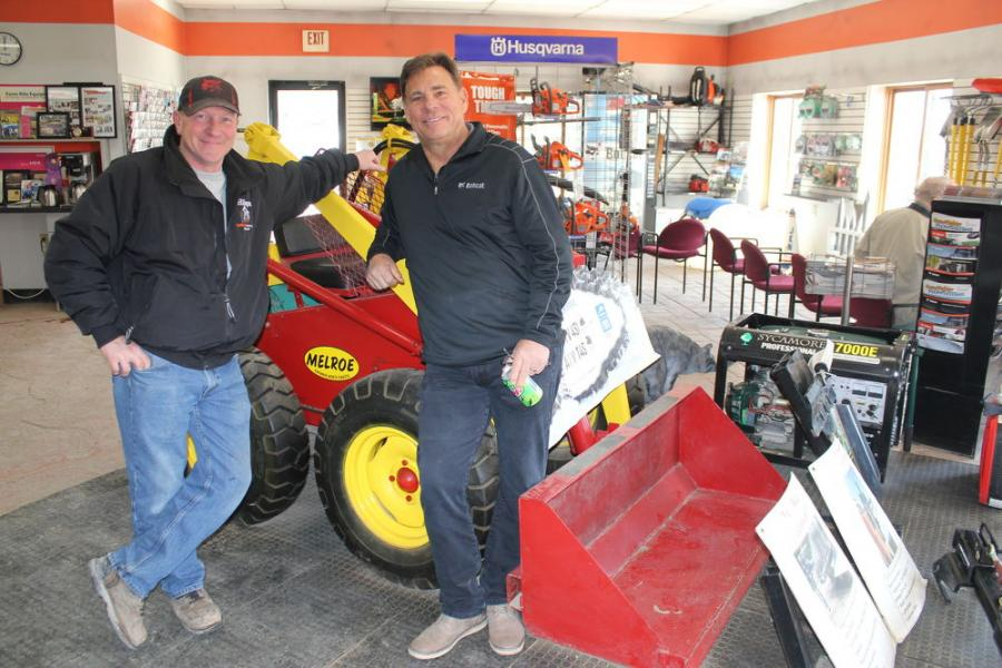 Troy Hilsgen (L), owner of Hilsgen Bobcat Service Inc. in Kimble, Minn., with Tim Krahn, Midwest regional sales manager of Bobcat, West Fargo, N.D., with Farm-Rite's restored floor model Melroe M200 — the first Melroe compact loader built to the designs of the Keller Brothers. It all started in the small town of Gwinner, N.D., where E.G. Melroe founded the Melroe Manufacturing Co.