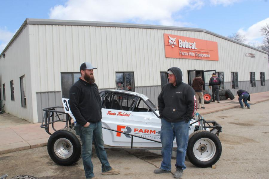 David Cox (L), sales manager of Farm-Rite Equipment in Dassel, Minn., with longtime customer Randy Niska of Precision Concrete in Cokato, Minn., take a look at this dirt track race car for Travis Trelstad. Farm-Rite is the main sponsor.