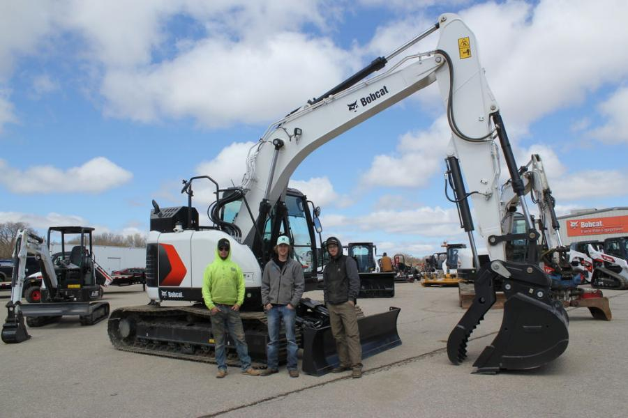 (L-R): Logan Mattila, foreman of Excel Concrete in Cokato, Minn.; Mark Johnson, equipment operator of Fred Johnson Inland Pools; and Eric Niska, equipment operator of Precision Concrete, Cokato, Minn., with one of the new Bobcat E145 excavators.