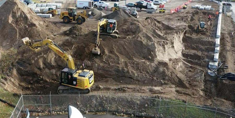 Excavation for the retaining wall and parking lot in progress.