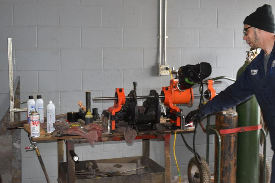 A demonstration of line boring, a process that would typically be used when buckets aren't quite fitting the way they should, is performed for the attending students.