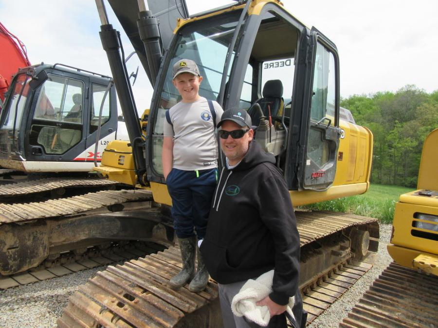 Thomas Brown of Outdoor Tranquility and his son, Ty, look over this John Deere 240D excavator.
