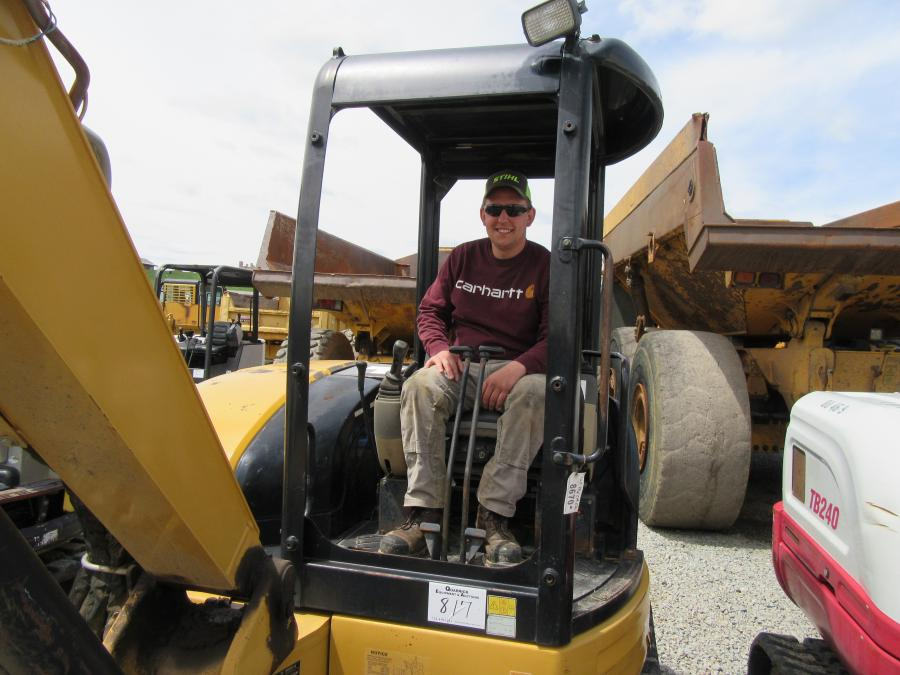 Steve Mizla of Apex Electrical Solutions tries out this Caterpillar 304 CR mini-excavator at the auction.