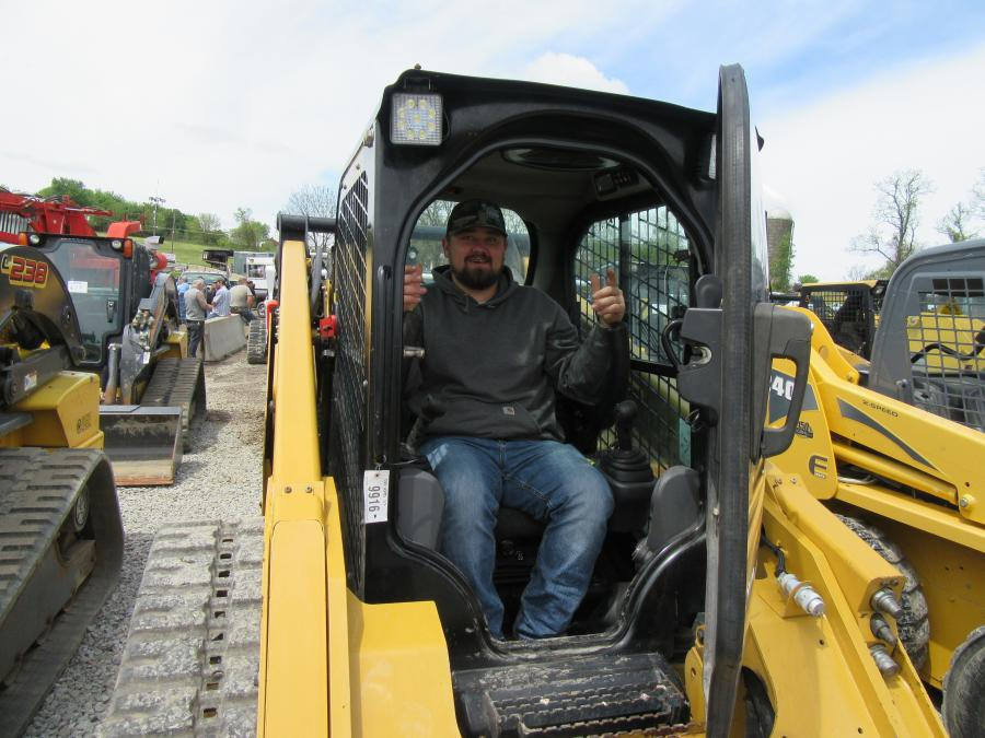Toby Grove of Grove Farms came in from Garrett County, Md., to look over the skid steers up for bid.